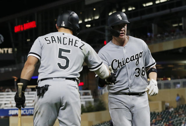 Chicago White Sox's Yolmer Sanchez, left, congratulates Zack Collins on his solo home run off Minnesota Twins pitcher Brusdar Graterol during the ninth inning of a baseball game Wednesday, Sept. 18, 2019, in Minneapolis. The White Sox won 3-1. (AP Photo/Jim Mone)