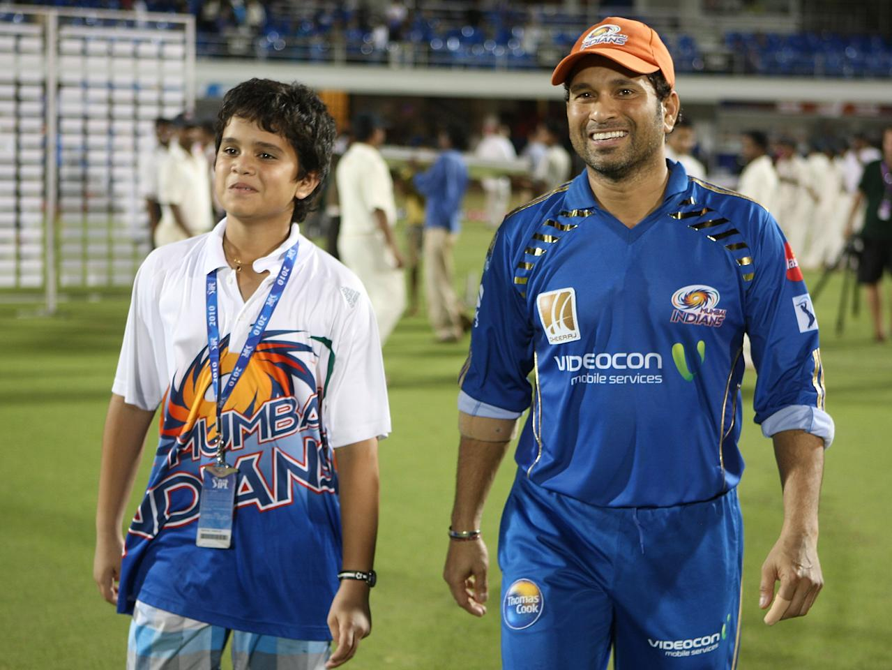 MUMBAI, INDIA - APRIL 13:  Sachin Tendulkar (R) of the Mumbai Indians with son Arjun Tendulkar (L) during the 2010 DLF Indian Premier League T20 group stage match between Mumbai Indians and the Delhi Daredevils played at Brabourne Cricket Stadium on April 13, 2010 in Mumbai, India.  (Photo by Chirag Wakaskar-IPL 2010/IPL via Getty Images)