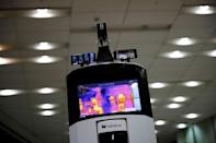 A self-driving robot checks a body temperature during its demonstration at the headquarter of SK Telecom in Seoul