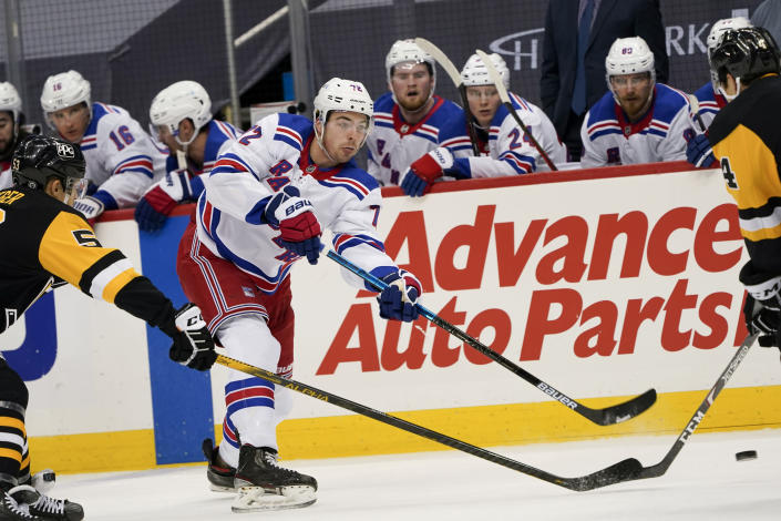 New York Rangers' Filip Chytil (72) shoots as Pittsburgh Penguins' Mike Matheson (5) defends during the second period of an NHL hockey game, Sunday, March 7, 2021, in Pittsburgh. (AP Photo/Keith Srakocic)