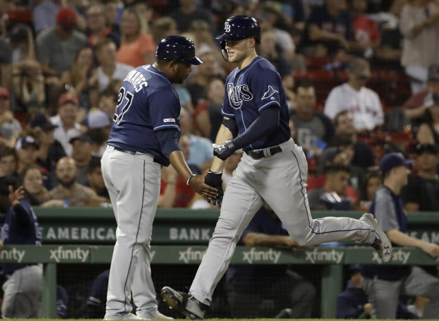 Tampa Bay Rays' Austin Meadows is congratulated by third base coach Rodney Linares (27) as he rounds the bases after his solo home run in the ninth inning of the team's baseball game against the Boston Red Sox at Fenway Park, Thursday, Aug. 1, 2019, in Boston. (AP Photo/Elise Amendola)