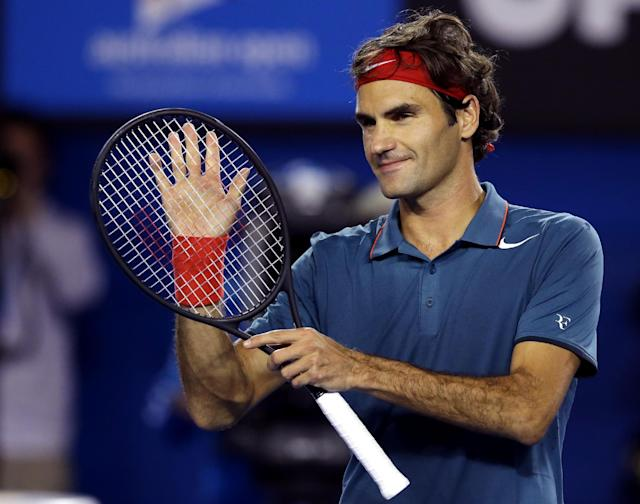 Roger Federer of Switzerland celebrates after defeating Jo-Wilfried Tsonga of France during their fourth round match at the Australian Open tennis championship in Melbourne, Australia, Monday, Jan. 20, 2014.(AP Photo/Aaron Favila)