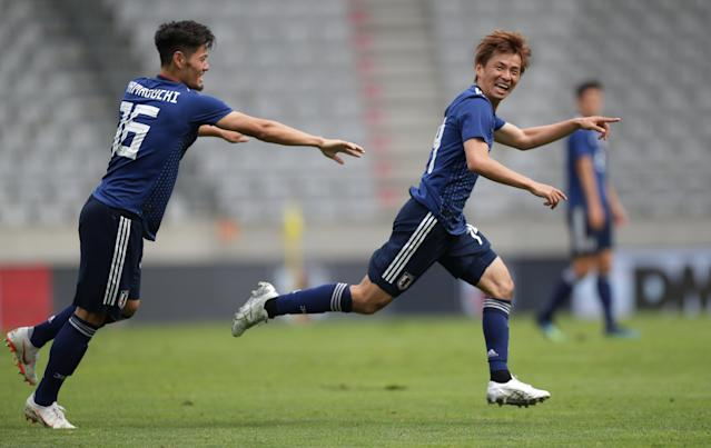 Soccer Football - International Friendly - Japan vs Paraguay - Tivoli-Neu, Innsbruck, Austria - June 12, 2018 Japan's Takashi Inui celebrates scoring their first goal with team mates REUTERS/Lisi Niesner