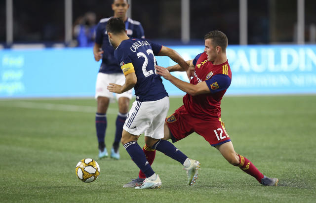 Real Salt Lake forward Brooks Lennon (12) defends against New England Revolution forward Carles Gil (22) during the second half of an MLS soccer match at Gillette Stadium, Saturday, Sept. 21, 2019, in Foxborough, Mass. (AP Photo/Stew Milne)