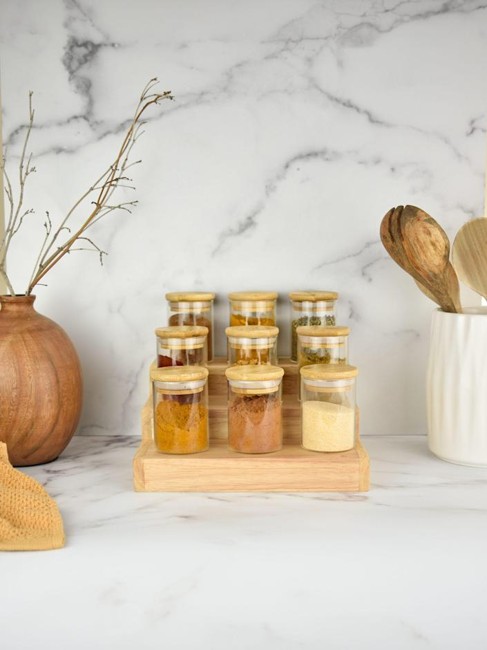 """Few things are more satisfying than a carefully curated and organized spice collection, and this tri-level acacia wood rack provides the perfect foundation. Splurge on the <a href=""""https://cna.st/affiliate-link/64ZhAxL8hjCHPUv7qRSwDRQUEncoD5EmhzKTu2XkrVTaL8ge6yVt7kST1q9jkxP8eC2pxAGav8RqD6DxtPem7Kaqbv6Ex31VP6Kz961k?cid=60944ec259e3e3029845b6d7"""" rel=""""nofollow noopener"""" target=""""_blank"""" data-ylk=""""slk:matching jars"""" class=""""link rapid-noclick-resp"""">matching jars</a> for a beautiful countertop display. $25, Sweet July. <a href=""""https://sweetjuly.com/product/spice-rack/"""" rel=""""nofollow noopener"""" target=""""_blank"""" data-ylk=""""slk:Get it now!"""" class=""""link rapid-noclick-resp"""">Get it now!</a>"""