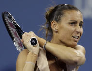 Flavia Pennetta, of Italy, returns a shot to Serena Williams, of the United States, during the quarterfinals of the U.S. Open tennis tournament Wednesday, Sept. 3, 2014, in New York. (AP Photo/Darron Cummings)