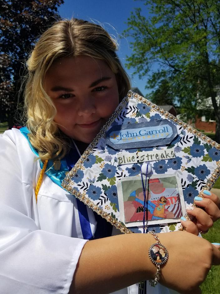 Mallory Dunlap, who describes herself as a daddy's girl, decorated her high school graduation cap as a tribute to her father, Lewis, who died of COVID-19.