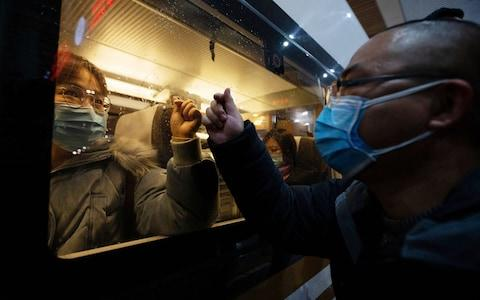 Medical teams headed to Wuhan board a train in Nanjing.  - Credit: STRINGER/EPA-EFE/REX