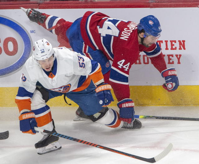 Montreal Canadiens centre Nate Thompson (44) is checked by New York Islanders center Casey Cizikas (53) during second period NHL hockey action, Tuesday, Dec. 3, 2019 in Montreal. (Ryan Remiorz/The Canadian Press via AP)