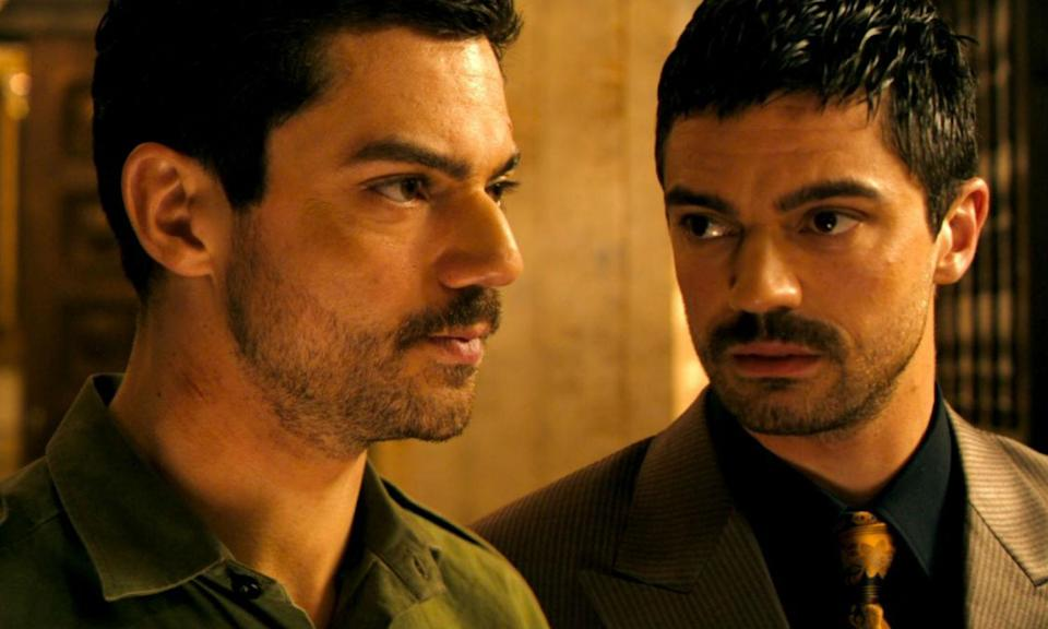 Dominic Cooper plays Uday Hussein and Latif Yahia in The Devil's Double, the 2011 film about a former school companion of Saddam Hussein's son who is violently coerced into becoming his body double. Actually a true story.