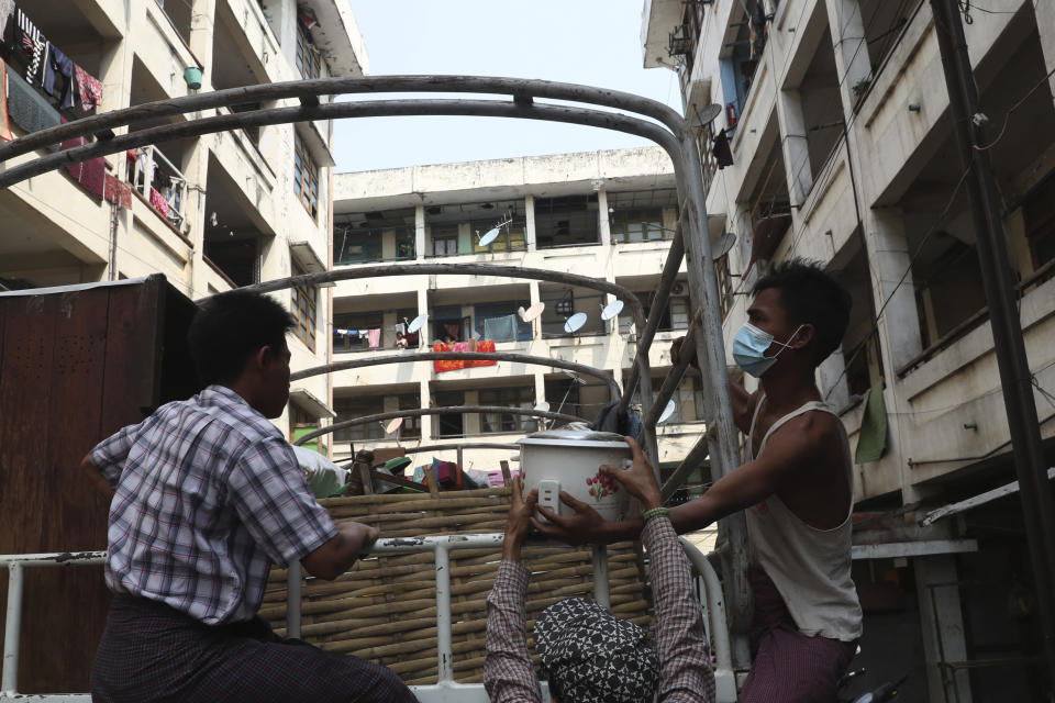 State railway employees load their belongings after being evicted from their home Saturday, March 20, 2021, in Mandalay, Myanmar. State railway workers in Mandalay have been threatened with eviction to force them to end their support for the Civil Disobedience Movement (CDM) against military rule. (AP Photo)