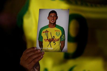 A fan holds a portrait of Emiliano Sala in Nantes' city center after news that newly-signed Cardiff City soccer player Emiliano Sala was missing after the light aircraft he was travelling in disappeared between France and England the previous evening, according to France's civil aviation authority, France, January 22, 2019. REUTERS/Stephane Mahe