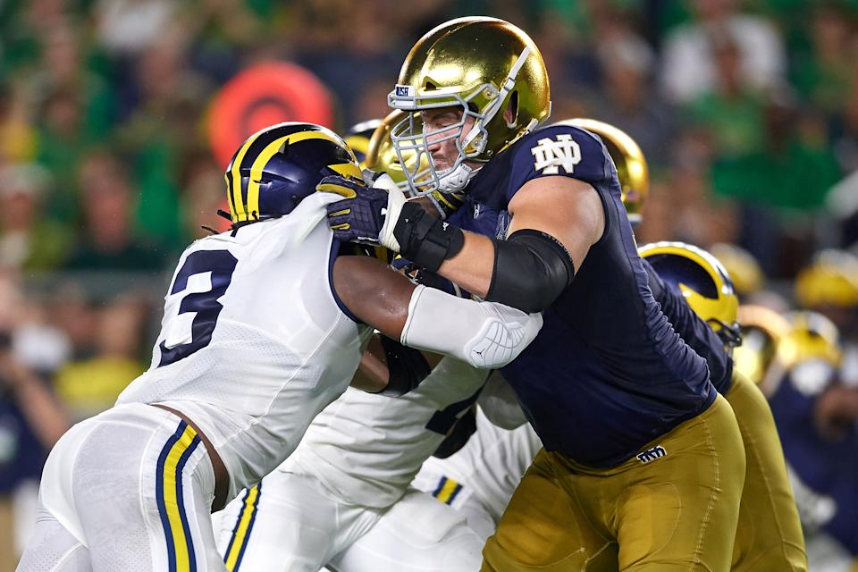 SOUTH BEND, IN - SEPTEMBER 01: Notre Dame Fighting Irish offensive lineman Liam Eichenberg (74) battles with Michigan Wolverines defensive lineman Rashan Gary (3) in game action during the college football game between the Michigan Wolverines and the Notre Dame Fighting Irish on September 1, 2018 at Notre Dame Stadium, in South Bend, Indiana. The Notre Dame Fighting Irish defeated the Michigan Wolverines by the score of 24-17. (Photo by Robin Alam/Icon Sportswire via Getty Images)
