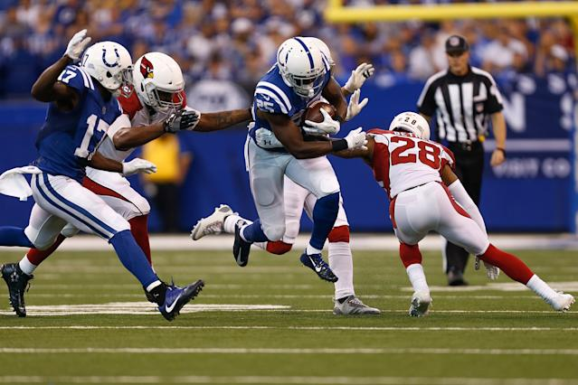 <p>Marlon Mack #25 of the Indianapolis Colts runs with the ball against the Arizona Cardinals during the second half at Lucas Oil Stadium on September 17, 2017 in Indianapolis, Indiana. (Photo by Michael Reaves/Getty Images) </p>