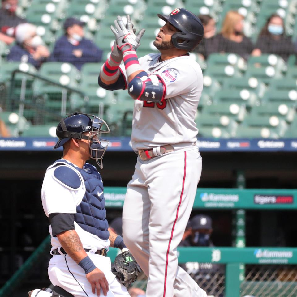Minnesota Twins designated hitter Nelson Cruz (23) after his grand slam against Detroit Tigers starting pitcher Jose Urena (62) during second inning action Monday, April 5, 2021, at Comerica Park in Detroit.