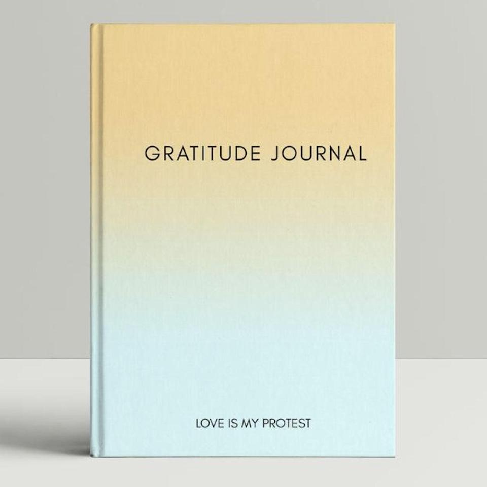 "Etsy has a long list of unique journals you won't come across every day, and this ombre design will bring some brightness to your morning routine. Keeping it simple with two prompts (what are you grateful for today, what was your favorite moment of the day), it's a great entryway into practicing gratitude on the regular. $26, Etsy. <a href=""https://www.etsy.com/listing/809339915/daily-gratitude-journal-thoughtful-gift"" rel=""nofollow noopener"" target=""_blank"" data-ylk=""slk:Get it now!"" class=""link rapid-noclick-resp"">Get it now!</a>"