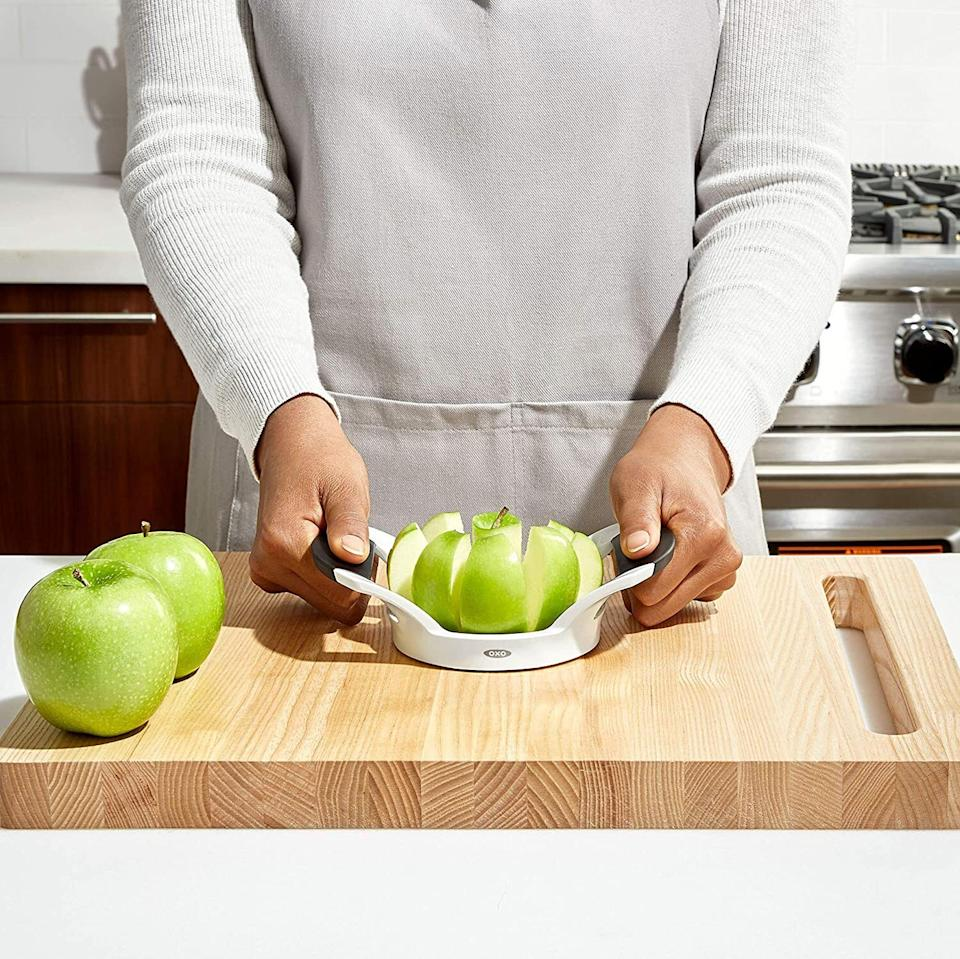 """You'll be able to quickly cut a healthy snack without being late to your Zoom meeting.<br /><br /><strong>Promising review:</strong>""""My husband laughed at this purchase questioning why we needed another gadget. Well, he ate his words the first time he tried it!<strong>This is the BEST gadget you never knew you needed.</strong>It perfectly cores and slices apples with a minimum of effort. It's the most-used gadget in our kitchen (we love apples). Highly recommend."""" —<a href=""""https://amzn.to/3ncQ86g"""" target=""""_blank"""" rel=""""noopener noreferrer"""">CT C</a><br /><br /><strong>Get it from Amazon for<a href=""""https://amzn.to/3tLoL5R"""" target=""""_blank"""" rel=""""noopener noreferrer"""">$9.99</a>.</strong>"""