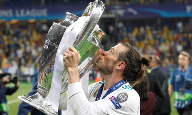 Gareth Bale kisses the trophy after his two goals helped Real Madrid to defeat Liverpool 3-1 in the Champions League final.