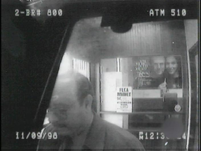 a still from security tape showing John Ruffo using an ATM in New York City in 1998