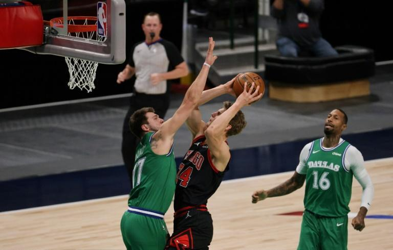 Dallas Mavericks star Luka Doncic guards Lauri Markkanen of the Chicago Bulls in the first quarter at American Airlines Center in Texas