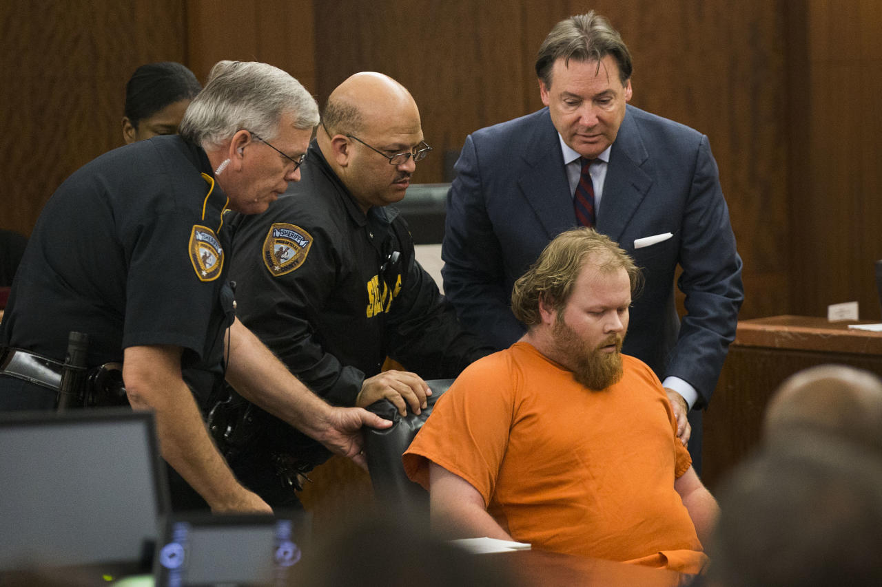 Ronald Lee Haskell collapses as he appears in court on Friday, July 11, 2014, in Houston. Haskell, 33, is accused of killing his ex-wife's sister, Katie Stay, her husband and the children, ranging in age from 4 to 14, after binding and putting them face-down on the floor of their suburban Houston home. (AP Photo/Houston Chronicle, Brett Coomer, Pool)