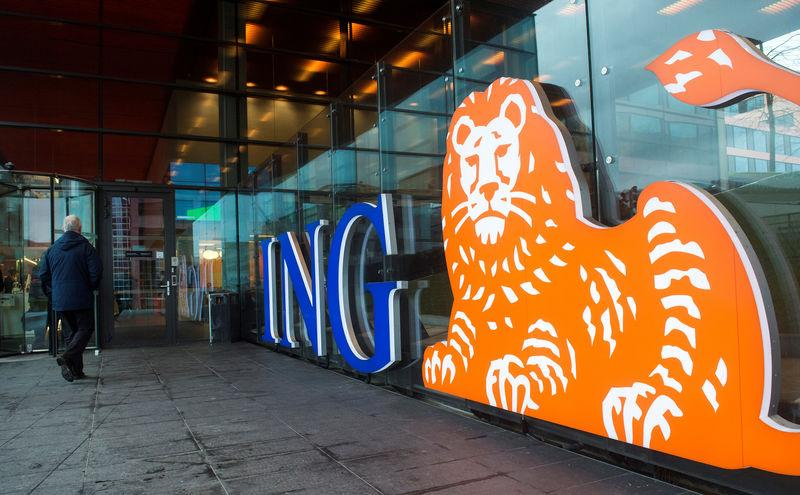 A man walks past the logo of ING Group NV at a branch office in Amsterdam