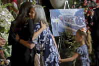 Edwin W. Edwards' daughter Anna and his great granddaughter Zoe, 6, right embrace Edwards' wife Trina, left, as the former Louisiana Governor lies in state in Memorial Hall of the Louisiana State Capitol in Baton Rouge, La., Saturday, July 17, 2021. The colorful and controversial four-term governor died of a respiratory illness on Monday, July 12. (AP Photo/Michael DeMocker)