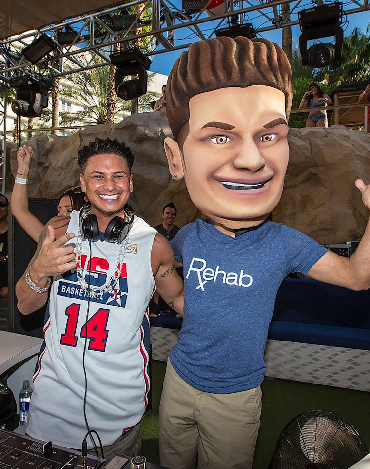 """Jersey Shore"" star DJ Pauly D needed a bit more attention while spinning tunes at the Hard Rock Hotel & Casino's Rehab pool party on Sunday. To solve the problem, he had a pal put on a giant Pauly D mask, so that fans could get a double dose of him. Well done! (10/7/2012)"