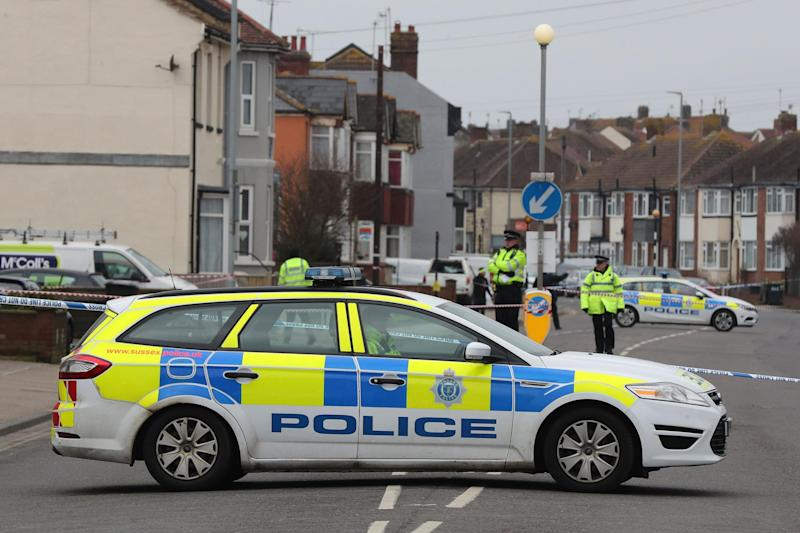 East Sussex: Police at the scene of the double shooting: PA