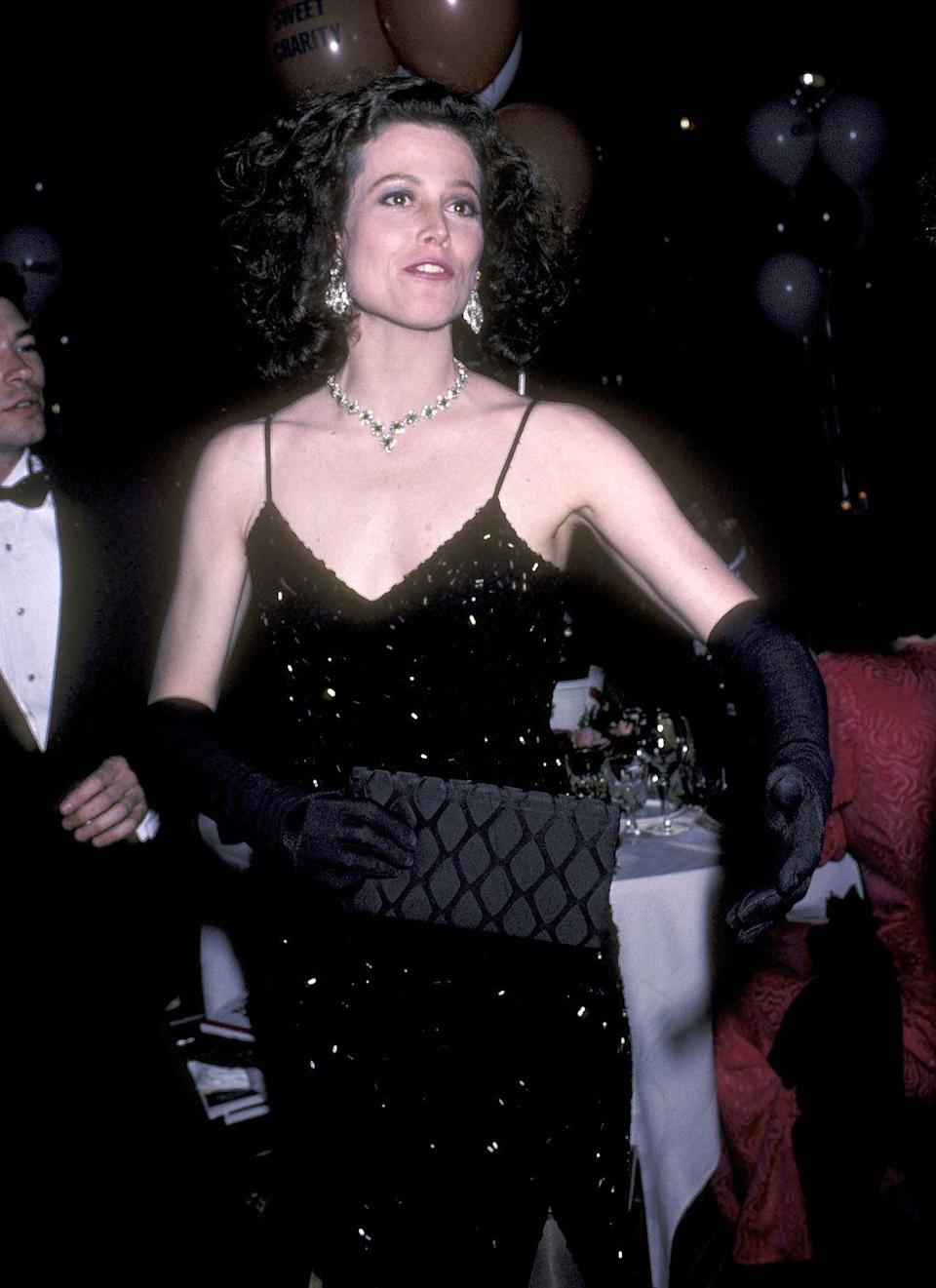 <p>No matter the shape or silhouette, 1985 was the year of the LBB, or the little black bag. Here, Sigourney Weaver paired hers with an LBD and matching gloves at the Tony Awards. </p>