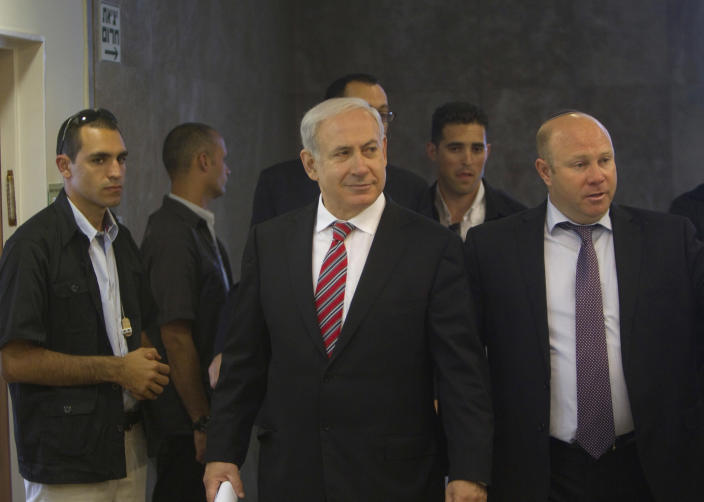 Israel's Prime Minister Benjamin Netanyahu, center, arrives to the weekly cabinet meeting in Jerusalem Sunday, April 29, 2012. (AP Photo/Ronen Zvulun, Pool)