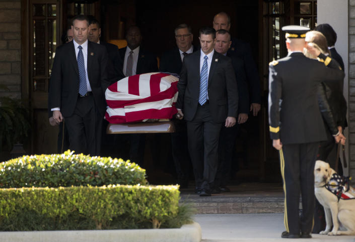 Pallbearers carry president George H.W. Bush's casket out of the George H. Lewis and Sons Funeral Home during the first departure ceremony for the State Funeral Monday, Dec. 3, 2018, in Houston. ( Photo: Godofredo A. Vasquez / Houston Chronicle via AP)
