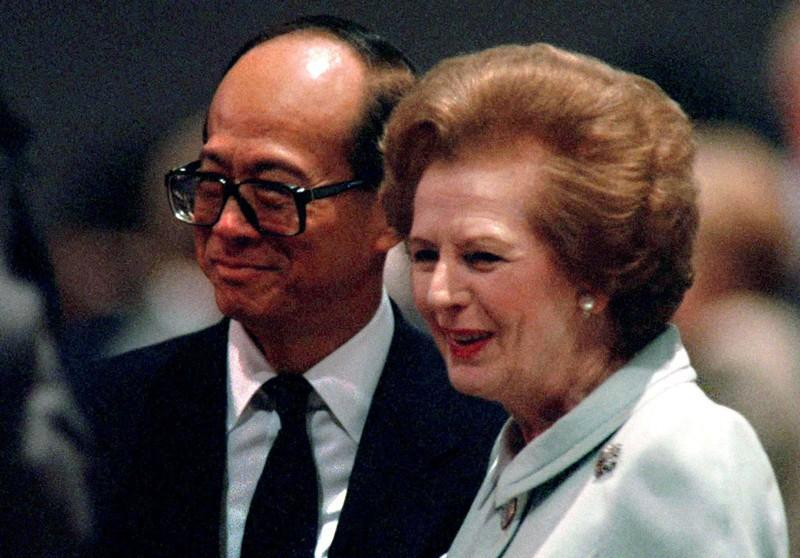 FILE PHOTO: Former British prime minister Margaret Thatcher poses for photographers with Hong Kong tycoon Li Ka-shing shortly before handover celebrations in the territory's Convention and Exhibition Centre, Hong Kong