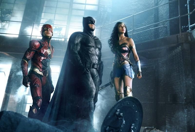 Ezra Miller as the Flash, with Ben Affleck's Batman and Gal Gadot's Wonder Woman in 'Justice League' (credit: Warner Bros)