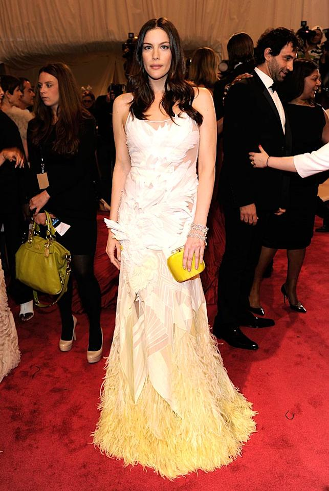"Liv Tyler struck a serious pose in a feathered Givenchy gown. Kevin Mazur/<a href=""http://www.wireimage.com"" target=""new"">WireImage.com</a> - May 2, 2011"
