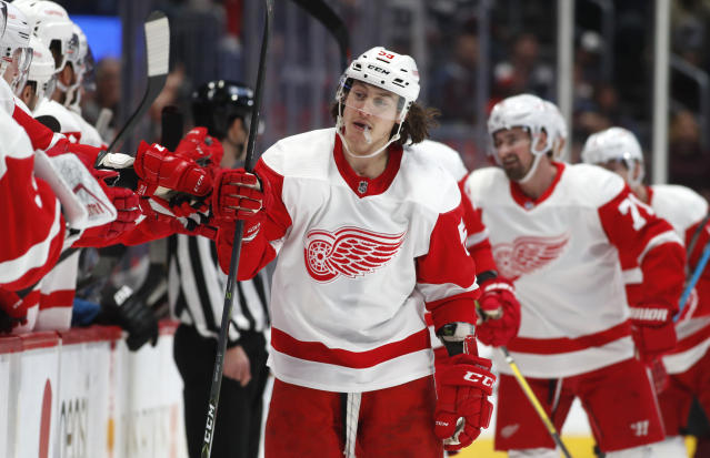 Detroit Red Wings left wing Tyler Bertuzzi is congratulated as he passes the team box after scoring a goal against the Colorado Avalanche in the first period of an NHL hockey game Monday, Jan. 20, 2020, in Denver. (AP Photo/David Zalubowski)