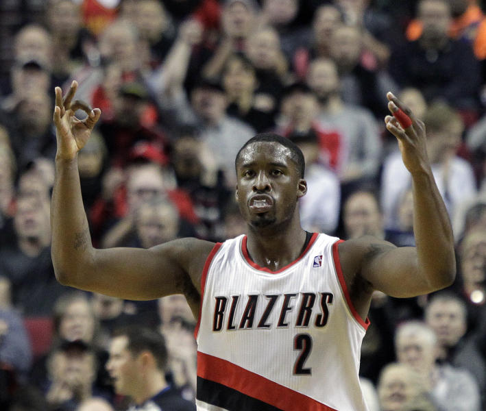 Portland Trail Blazers guard Wesley Matthews signals after sinking a three point shot during the first half of an NBA basketball game against the Oklahoma City Thunder in Portland, Ore., Wednesday, Dec. 4, 2013. (AP Photo/Don Ryan)