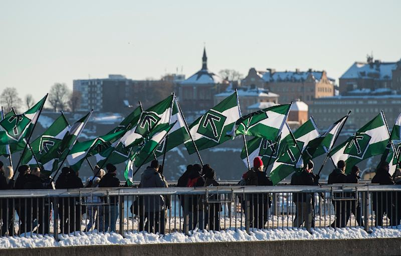 The neo-nazi Nordic Resistance Movement sympathisers demonstrate in central Stockholm on November 12, 2016 to protest against migrants