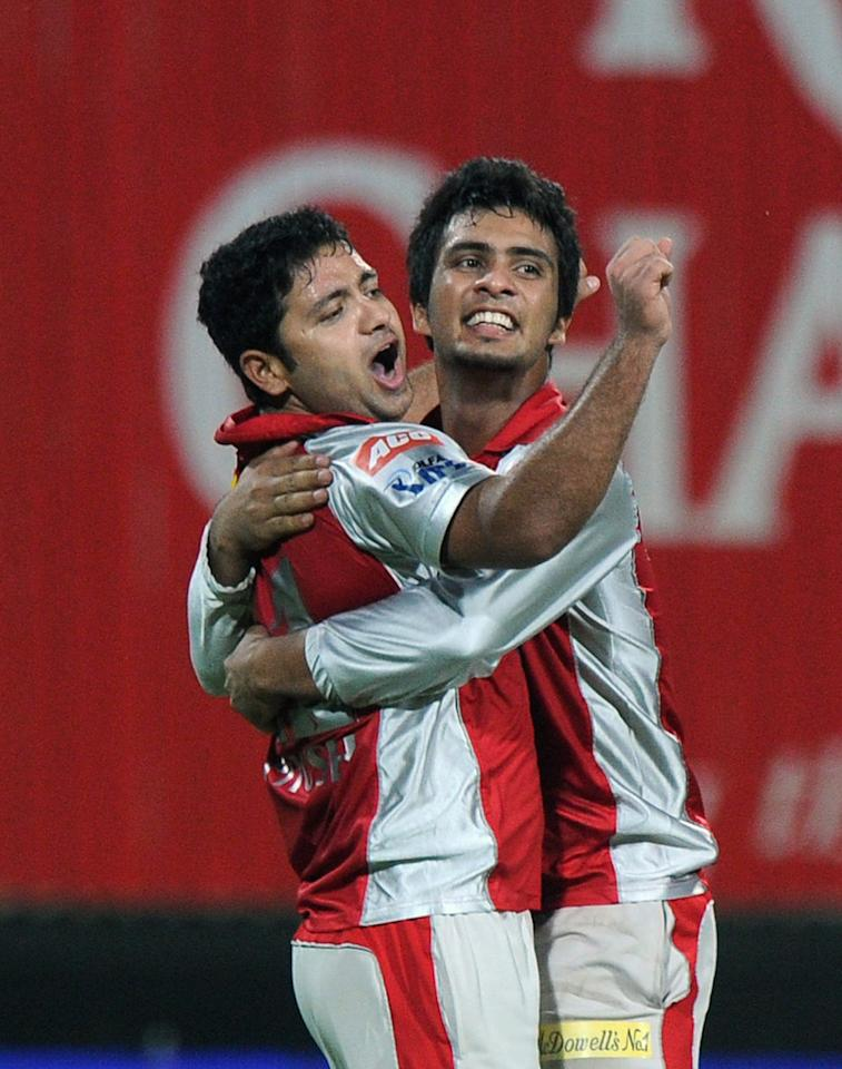 Kings XI Punjab bowler Piyush Chawla (L) and teammate Mandeep Singh (R) celebrate after taking the wicket of Kolkata Knight Riders batsman Yusuf Pathan (unseen) during the IPL Twenty20 cricket match between Kolkata Knight Riders and Kings XI Punjab at The Eden Gardens in Kolkata on April 15, 2012. RESTRICTED TO EDITORIAL USE. MOBILE USE WITHIN NEWS PACKAGE. AFP PHOTO/Dibyangshu SARKAR (Photo credit should read DIBYANGSHU SARKAR/AFP/Getty Images)