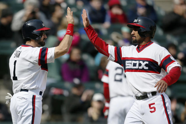 Chicago White Sox Adam Eaton, left, and Marcus Semien, right, high-five after scoring against the Tampa Bay Rays during the seventh inning of a baseball game, Sunday, April 27, 2014, in Chicago. (AP Photo/Andrew A. Nelles)