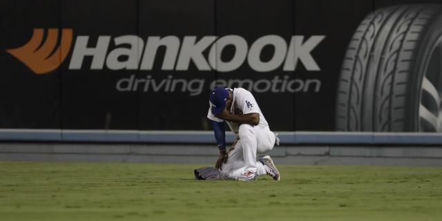 Los Angeles Dodgers' Yasiel Puig reacts after diving for a ball hit by Houston Astros' Alex Bregman during the eighth inning of Game 2 of baseball's World Series Wednesday, Oct. 25, 2017, in Los Angeles. (AP Photo/David J. Phillip)