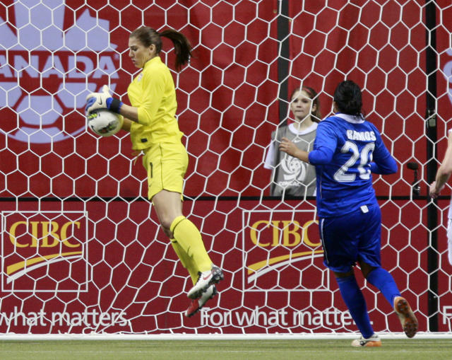 VANCOUVER, CANADA - JANUARY 22: Katherine Ramos #20 of Guatemala looks on as Hope Solo #1 of the United States makes a save during the 2012 CONCACAF Women's Olympic Qualifying Tournament at BC Place on January 22, 2012 in Vancouver, British Columbia, Canada. The United States won 13-0. (Photo by Jeff Vinnick/Getty Images)