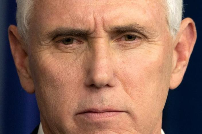US Vice President Mike Pence, President Donald Trump, and other senior White House officials have pointedly ignored the advice to wear face masks in public settings, leading to speculation it is a coordinated decision to downplay the severity of the crisis (AFP Photo/JIM WATSON)