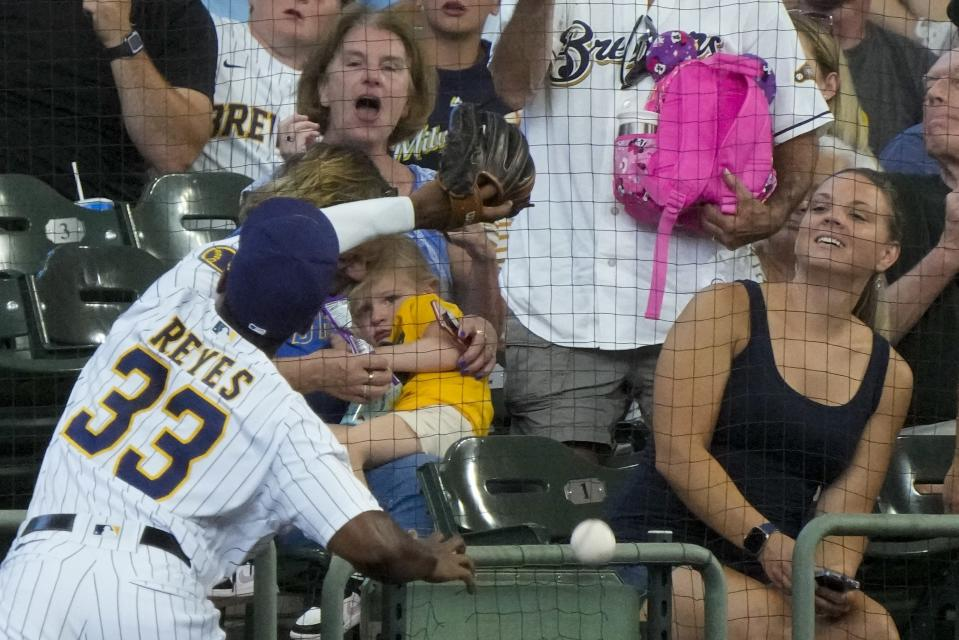 Milwaukee Brewers' Pablo Reyes can't catch a foul ball hit by Pittsburgh Pirates' Colin Moran during the third inning of a baseball game Saturday, June 12, 2021, in Milwaukee. (AP Photo/Morry Gash)