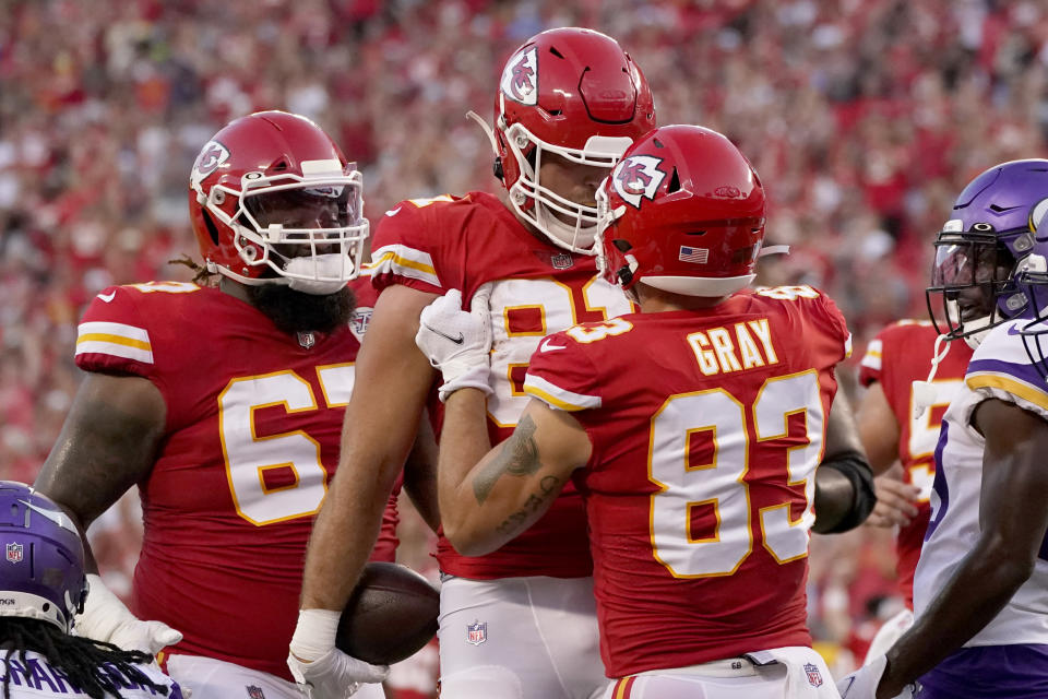 Kansas City Chiefs tight end Blake Bell (81) is congratulated by Noah Gray (83) and Lucas Niang (67) after scoring during the first half of an NFL football game against the Minnesota Vikings Friday, Aug. 27, 2021, in Kansas City, Mo. (AP Photo/Charlie Riedel)