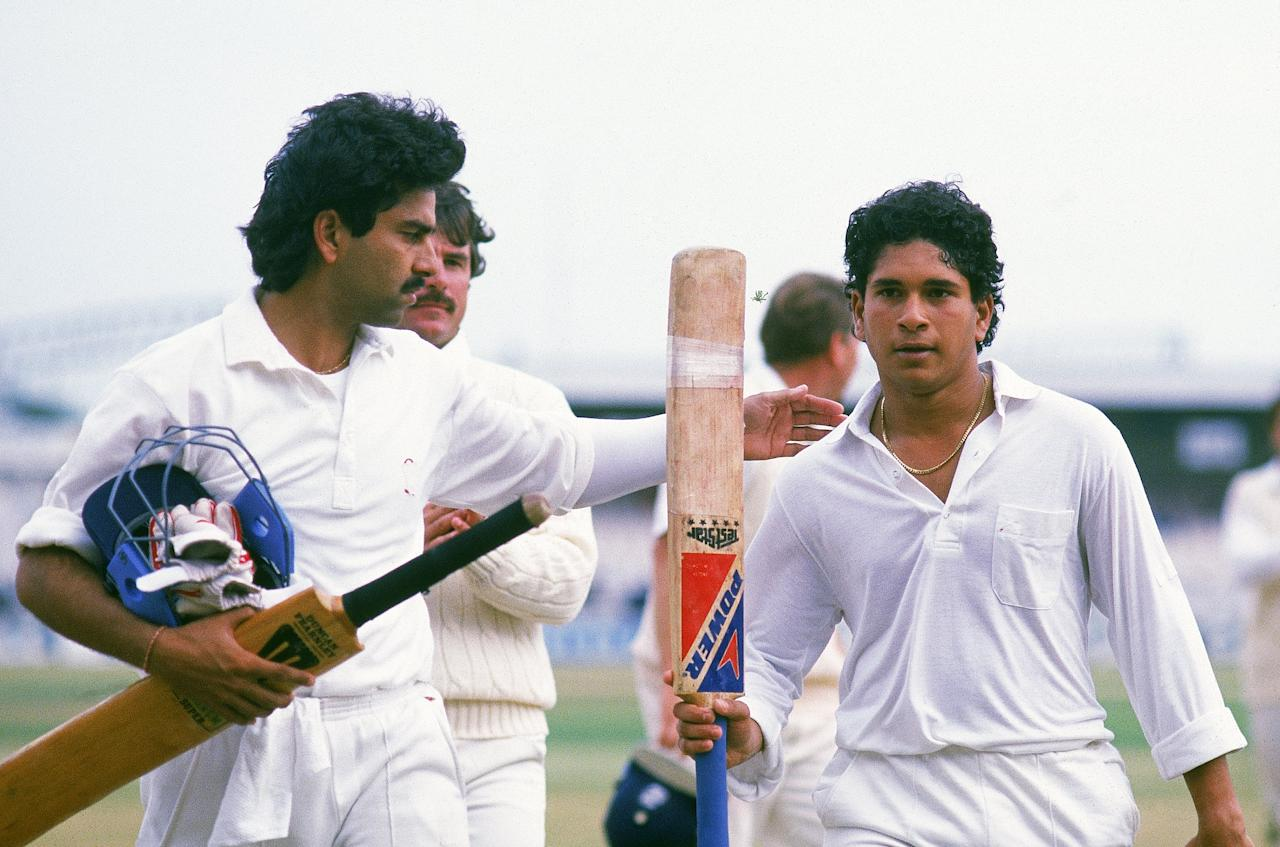 11 Aug 1990:  Sachin Tendulkar of India celebrates hitting 119 runs not out during the Second Test match against England played at Old Trafford, in Manchester, England. \ Mandatory Credit: Ben Radford /Allsport