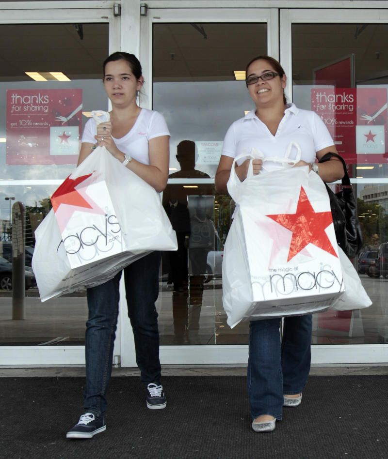 FILE - In this file photo taken Sept, 29, 2011, Elsy Santiago, left, and her sister Betsy shop at a store in Hialeah, Fla.  Consumers boosted their spending in September at three times the pace of the previous month but their incomes barely budged. They financed the gains from savings, sending the savings rate to the lowest level since the start of the Great Recession. (AP Photo/Alan Diaz, File)