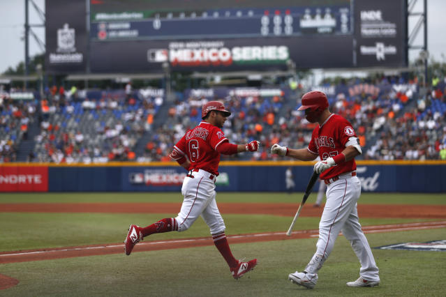 Los Angeles Angels' David Fletcher, left, is congratulated by teammate Mike Trout after hitting a home run in the first inning of a baseball game against the Houston Astros, in Monterrey, Mexico, Sunday, May 5, 2019. (AP Photo/Rebecca Blackwell)