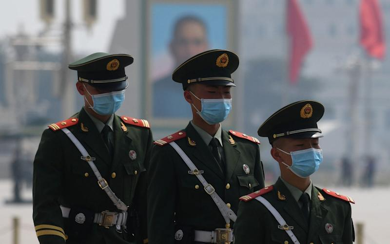 Paramilitary police officers wear masks as a preventive measure against the COVID-19 coronavirus  - AFP