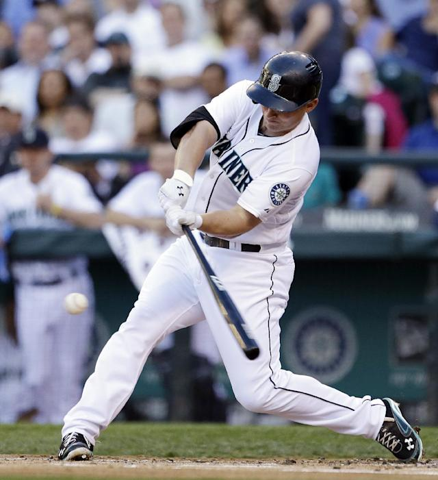 Seattle Mariners' Kyle Seager drives in a run with a double against the Cleveland Indians in the first inning of a baseball game Tuesday, July 23, 2013, in Seattle. (AP Photo/Elaine Thompson)